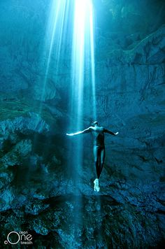 Freediving Photography - Freediving the Cenotes of the Yucatan Peninsula, Mexico. Photo taken on one breath by Christina Saenz de Santamaria.