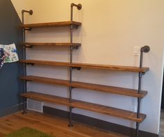 Large industrial pipe shelving unit by PipeFurnitureDesigns