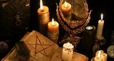 Mystic still life with evil book, burning candles, clock and mirror. Halloween concept, black magic ritual or spell with occult and esoteric symbols, divination Wiccan, Magick, Witchcraft, Revenge Spells, Black Magic Spells, Moon Spells, Love Spell Caster, Protection Spells, Cartomancy