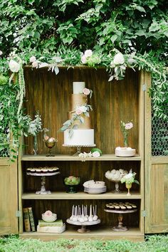 Lush greenery and shimmering metallics mark this deliciously beautiful dessert display. | Photo by Merari | Cakes and confections by Earth and Sugar