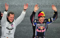 German Formula One World Champion Sebastian Vettel (R) and German F1 driver and seven times World champion Michael Schumacher celebrate after winning the Nations Cup of the Race of Champions (ROC) in Duesseldorf, western Germany, on November 27, 2010. The race, featuring 28 motor racing World Champions takes place on the weekend of 27 and 28 November and the drivers will compete following the knockout system on a 1000 meter race track at Esprit Arena.