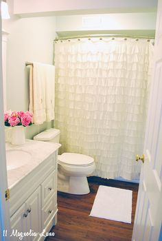 Love the ruffled shower curtain and wall color. Preparing Your Home for Summer Guests | 11 Magnolia Lane