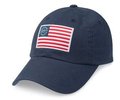 75e38bd0567 The Southern Tide Grand Ole Flag Hat features an American Flag inspired  patch on the front   an adjustable strap ...