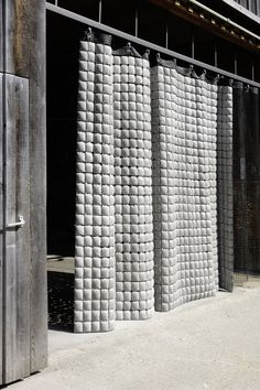 Betonvorhang (CONCRETE CURTAINS) by Christine Pils and Werner Schedler. The colour and form of the concrete cushions are adaptable to the respective functions. The concrete curtains can be used as a sun and windscreen, privacy screen, facade element or heat accumulating room partition. The product won the red dot design award in 2008.