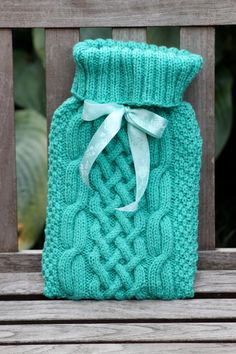 Free hot water bottle cover knitting patterns pinterest hand knitted arran hot water bottle cover with silk ribbon tie detail at the neck dt1010fo