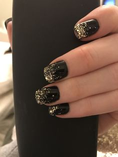 Black polish with gold tips that trickle down the nail. One of my faves!