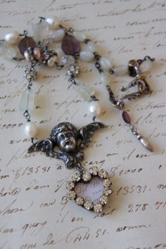 Vintage assemblage necklace Valentines french postcard cherub gemstones pearls assemblage jewelry - Love Note by French Feather Designs..via Etsy.