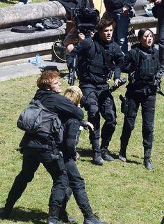 Finnick protects Katniss from hijacked Peeta -- Mockingjay: Part 2