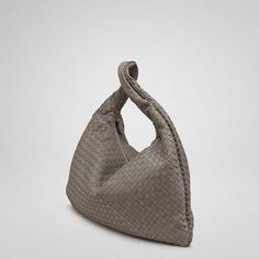 """Inspired by the shape of the timeless hobo, the traditional Veneta is a signature element of Bottega Veneta's handbag collection. Dimensions:20.1"""" W x 19.7"""" H x 2"""" D"""