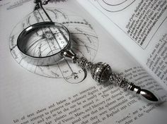 Steampunk Magnifying Glass with Sterling Silver beads. via Etsy. Lara Croft, Steampunk, The Grisha Trilogy, His Dark Materials, Trigger Happy Havoc, Six Of Crows, A Series Of Unfortunate Events, Magnifying Glass, Sherlock Holmes