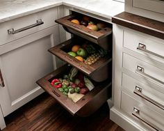 Space saving kitchen pull-outs for fruits and veggies.