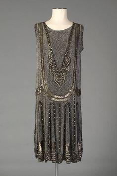 Black chiffon sleeveless dress with allover beaded design, English, mid-1920s, Via Kent State University Museum