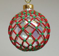 Clear Christmas ornament with red and green beaded netting Clear Christmas Ornaments, Beaded Christmas Decorations, Christmas Love, Christmas Themes, Christmas Crafts, Christmas Holidays, Beaded Ornament Covers, Beaded Ornaments, Handmade Ornaments