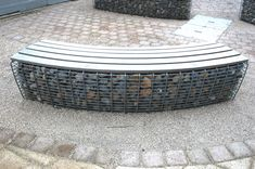 Curved gabion bench, with mesh that looks especially sturdy.