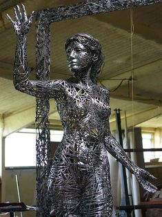32- El Umbral.-Figurative Sculptures Welded from Steel Scraps by Jordi Diez Fernandez steel sculpture
