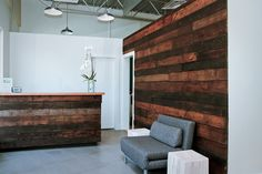 Reception. Reclaimed wood feature wall & desk detail. www.barrefitness.com/north-shore/