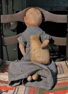 Kim Sivak.  Brown hair farm doll is made of antique cotton cloth and is heavily stuffed with cotton quilt seeded batting. She has a wonderful feel to her, nice and heavy and lumpy, just like an early doll.