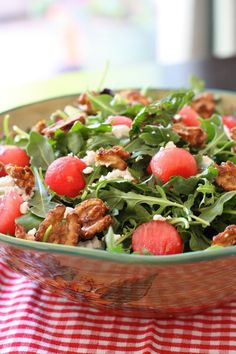 Watermelon salad with arugula, goat cheese, and candied walnuts.