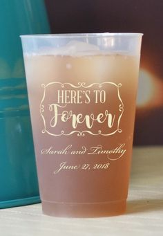 Personalized 14 Ounce reusable shatterproof frosted plastic wedding cups are the perfect size for serving 12 oz. cans of soda, beer, or canned alcoholic beverages with ice to your wedding guests. Tell everyone to take these dishwasher safe souvenir cups home when they leave the reception to use at home. These cups personalized with Here's To Forever design, bride and groom's name and wedding date can be ordered at…