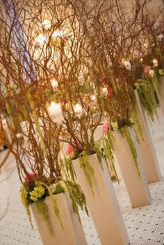 tall willow branches to add height to the floral arrangements  {A Grand Wedding! | Flora Nova Design - The Blog}