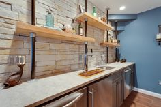 contemporary industrial kitchen and bar idea with industrial open shelves made of wooden white countertop stainless steel appliances grey cabinets pale toned industrial bricks backsplash blue walls of Dislike Mainstream Kitchen Shelving? These Tens Industrial Kitchen Shelving Ideas Might Be Your Favorite