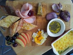 fun food board. cream of pea, lentil and potato with cheese and garlic melts. chilled soft boiled egg, fresh fruit, roasted onion heart (pre poached in white peppercorn, garlic, milk bath), pate, cranberry conserve, ham, ciabatta. terragon salt black pepper olive oil.