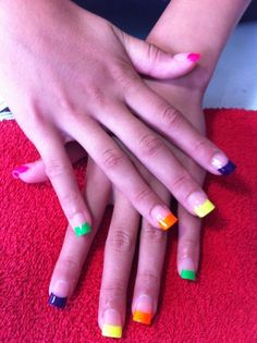 Fluro Nails by Petite Nails and surmanti. Great for clubbing. They glow in the dark!