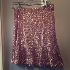 Never worn pink sequence skirt Very pretty tags are still on it. Its great for a night out. Nasty Gal Skirts Midi