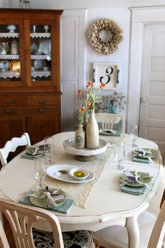 The lace edging on the shelves in the hutch give this dining room a cozy feeling....The Vintage House