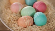 String-Dyed Easter Eggs  I did this as a kid by wrapping eggs with rubberbands before dying!