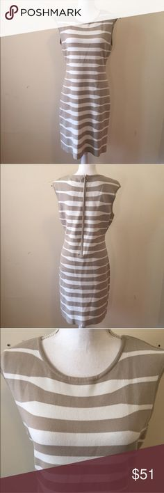 Calvin Klein Striped Bodycon Dress Bodycon dress from Calvin Klein in a tan and white stripe fabric. Zips in back. Size Large, great condition! Calvin Klein Dresses