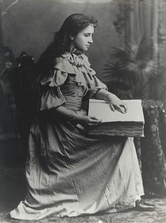 Portrait of Helen Keller reading an embossed book. Visit the Perkins Archives flickr collection: http://www.flickr.com/photos/perkinsarchive/collections/