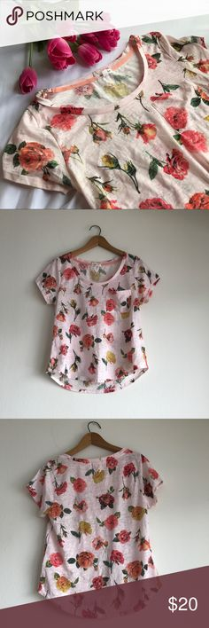 Skylar + Jade Blush Floral Pocket Tee Size Medium Gently used.  Has a small purple stain down near the bottom hem in the front (please see the last photo). The tee is a light blush pink color and has a floral design.  Width (measured armpit to armpit): approximately 17 1/4 inches.  Length (measured shoulder to bottom hem): approximately 22 1/4 inches. skylar + jade Tops Tees - Short Sleeve