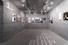 PROJECT DESCRIPTIONWe were commissioned to design the exhibition Re_konstrukció for Budapest based architect studio Hetedik Műterem. Five highlighted projects were selected to be presented in an underground room with grey painted concrete walls. We retou…