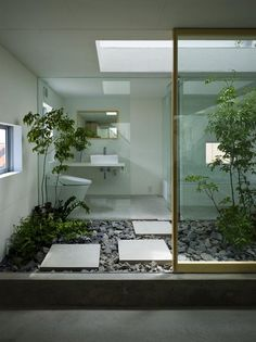 From Japanese gardens in your outdoor home to wide expansive uses of glass that have minimal mullions to interrupt the view, Japanese inspired interiors have a connection with nature. House in Moriyama.  Design: Suppose design office, architects.  Location: Nagoya, southwest Japan.  Photos: Toshiyuki Yano.