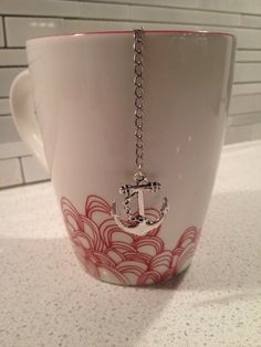 Just ordered this! Anchor Mesh Ball Tea Infuser by CleverKarma on Etsy - or just hang 1 or 2 nice charms on a ordinary tea ball chain Cuppa Tea, Tea Strainer, My Cup Of Tea, Cute Mugs, Loose Leaf Tea, Tea Accessories, Looks Cool, Drinking Tea, Tea Time