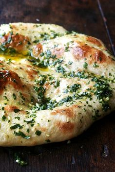 naked pizza with herbs + garlic.  Different name, we use it as herbed bread with a pasta dish or as a side for soups. Make dough the night before.