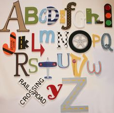 Transportation Alphabet - Painted-transportation, alphabet, wooden letters, wall letters, plane, airplane, railroad crossing, signs, cars, trains, stoplight