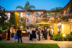 Kick off your reception with cocktail hour on our Garden Terrace - an ambiance sure to stun your guests.  Photo Credit: Fonyat Weddings Photography #cocktailhour #hgicarlsbad #carlsbadwedding #sandiegowedding #sandiego #carlsbad #cocktails #marketlighting #outdoorwedding #beachwedding