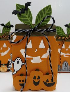 Stampin' Up Everyday Jar  Pumpkin Lantern/Treat Holders created by Lynn Gauthier using SU's Flourishing Phrases, Sweet Home, Jar of Haunts,  Home Sweet Home, Halloween Scares, Spooky Fun  and Cookie Cutter Halloween Stamp Sets and Everyday Jars Framelits and Halloween Scenes Edgelits Dies.  Go to http://lynnslocker.blogspot.com/2016/08/stampin-up-sneak-peek-2016-2017-holiday.html to see how these Pumpkin Lantern/Treat Holders were made.