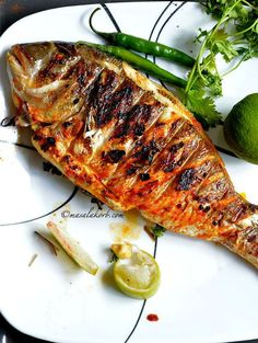 Grilled Fish Indian Recipe has all the Indian flavours and spices that penetrate deep into the fish making it juicy & succulent from inside & beautifully charred on the outside. Grilled Fish Recipes, Spicy Recipes, Grilling Recipes, Seafood Recipes, Indian Food Recipes, Asian Recipes, Cooking Recipes, Healthy Recipes, Grilled Fish Marinade