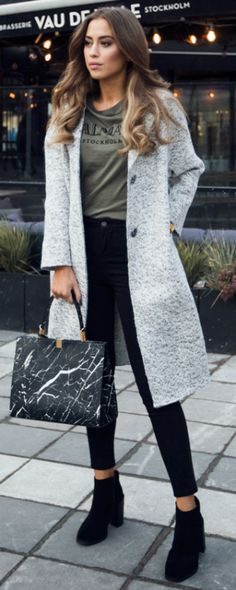 Wearing a graphic tee is a sure fire way of achieving a casual but kooky style. Kenza Zouiten wears this Balmainx tee with simple black jeans, chunky black boots, and a sophisticated grey overcoat. Coat: Zara, T-Shirt: Balmainx, Shoes: Jennie-Ellen, Bag: Balenciaga, Jeans: Asos.