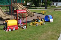 """Playground Train Engine- Say """"All-Aboard"""" with this fun Train Engine for imaginative role play with for your kids!  Can fit up to 3 children. The fully assembled train is portable or permanent and perfect for indoor and outdoor use. It features one crawl tube, steering wheel and benches, and is the basis for theme learning from geography to life skills. Add it to the Passenger Car and Caboose to make a complete set!    Can purchase all three as a set (Train Engine, Passenger Car and Caboose)…"""