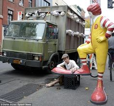 And in Greenwich Village, two Banksy works, 'Sirens of the Lambs' and 'Shoe Shining Ronald McDonald' made a rare appearance together outside...