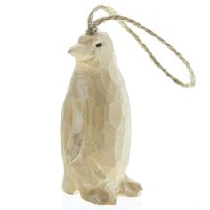 "The natural, artisan-carved ornament is a perfect take on the adored animals of the poles. Hang it on door knobs, walls, or anywhere for a great décor. - Dimensions: 1""W x 1.5""L x 2.75""H - Color: Natu"