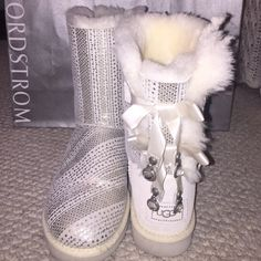 BLING UGG BOOTS Omg who doesn't love these!! Perfect for the ultimate snow princess ❄️ these gorgeous metallic Uggs are covered with a silver pattern and lined with Ugg's signature fur in white. The back of the boots are my favorite! Silk bows with some bling dangles and the UGG stamp surrounded by crystals as well. I've only worn these a handful of times, barely any wear on the bottom. FEEL FREE TO MAKE AN OFFER! UGG Shoes Winter & Rain Boots