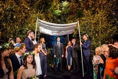 A creative indoor forest Jewish wedding with a Ritva Westenius bride in London | Smashing the Glass Jewish wedding blog | bringing the outdoors in ... in a BIG way! Dramatic floral details, a bespoke gown, and tons of meaningful moments