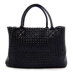 Exquisitely woven details throughout the framework of this purse make up a unique textured construction. This tote from Dime City features a roomy interior with a detachable purse inside. Color option