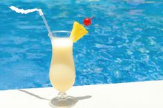 Sip your cares away! A Piña Colada is a staple of a Dreams Resorts and Spas vacation.