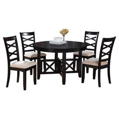 Gather family and friends for both weekend dinner parties and casual meals around this classic dining set, showcasing crossed accents and 4 upholstered side ...